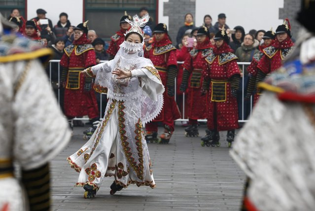 An actress in rollerblades performs a scene of a love story during Imperial times outside the Old Summer Palace fair during the week-long Spring Festival holiday season in Beijing, China, 20 February 2015. Chinese people around the world celebrated the Chinese New Year, also called Spring Festival, which ushered in the Year of the Goat. (Photo by Rolex Dela Pena/EPA)