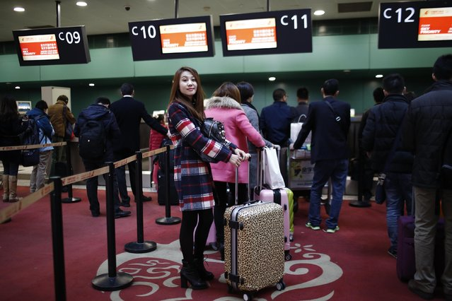 Gao poses for a portrait at Hongqiao airport as she wait to check in her luggage in Shanghai, February 12, 2015. Gao travelled to Jiangxi province by plane to spend Chinese New Year with her family. (Photo by Carlos Barria/Reuters)