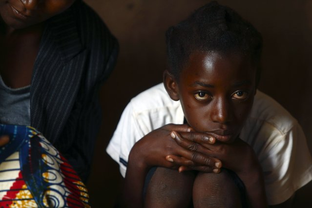 11-year-old Sonia Matanga, who was born HIV-positive, attends a self-help group meeting with a caregiver in the village of Michelo, south of the Chikuni Mission, in the south of Zambia February 23, 2015. (Photo by Darrin Zammit Lupi/Reuters)