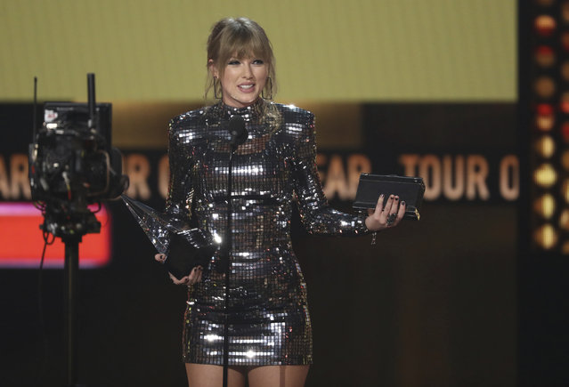 Taylor Swift accepts the award for tour of the year at the American Music Awards on Tuesday, October 9, 2018, at the Microsoft Theater in Los Angeles. (Photo by Matt Sayles/Invision/AP Photo)