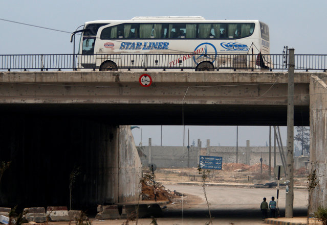 A bus bringing people out of eastern Aleppo drives back in the direction of the besieged rebel enclave, Syria December 16, 2016. (Photo by Omar Sanadiki/Reuters)