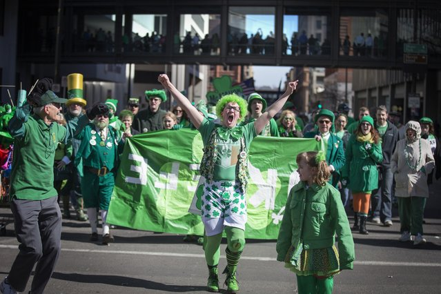 Garrett O'Keefe marches with his family during the 49th annual St. Patrick's Day parade in downtown St. Paul on Tuesday, March 17, 2015. (Photo by Leila Navidi/The Star Tribune)