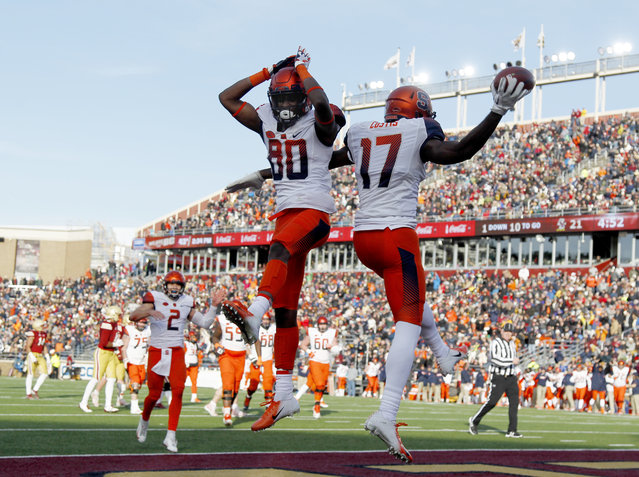 Syracuse wide receiver Jamal Custis (17) celebrates with teammate Taj Harris (80) after scoring a touchdown during the second half of an NCAA college football game against Boston College, Saturday, November 24, 2018, in Boston. (Photo by Mary Schwalm/AP Photo)