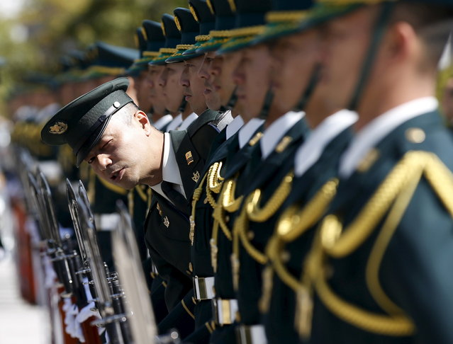 Members of Japan's Self-Defence Force's honour guard prepare for a ceremony for U.S. Army General Martin Dempsey, chairman of the Joint Chiefs of Staff, at the Defense Ministry in Tokyo March 25, 2015. (Photo by Toru Hanai/Reuters)