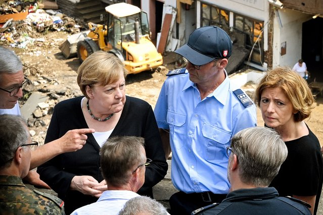 German Chancellor Angela Merkel (2-L) and Rhineland-Palatinate Premier Malu Dreyer (R) inspect the damage after heavy flooding of the river Ahr caused severe destruction in the village of Schuld, Ahrweiler district, Germany, 18 July 2021. Large parts of western Germany were hit by heavy, continuous rain in the night to 15 July, resulting in local flash floods that destroyed buildings and swept away cars, killing dozens of people, while several were still missing. (Photo by Sascha Steinbach/EPA/EFE)