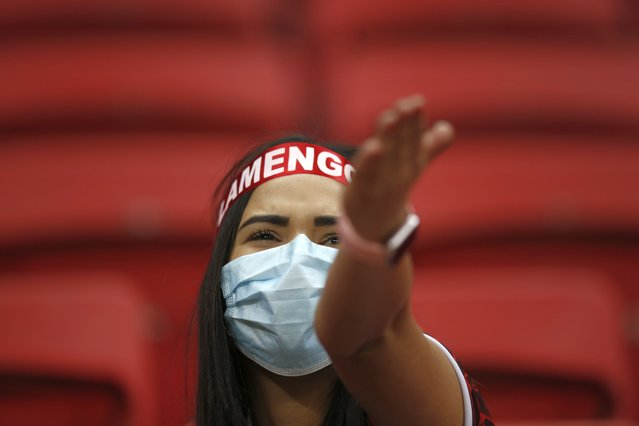 A Brazil Flamengo fan cheers before the start of a Copa Libertadores round of 16 second leg soccer match between Brazil's Flamengo and Argentina's Defensa y Justicia, the first game with fans amid the COVID-19 pandemic at the National Stadium in Brasilia, Brazil, Wednesday, July 21, 2021. (Photo by Adriano Machado/Pool via AP Photo)