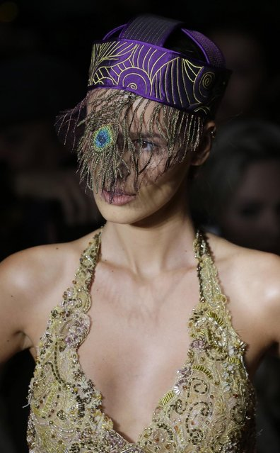 A model wears a creation from the Lino Villaventura summer collection during Sao Paulo Fashion Week in Sao Paulo, Brazil, Thursday, April 16, 2015. (Photo by Nelson Antoine/AP Photo)