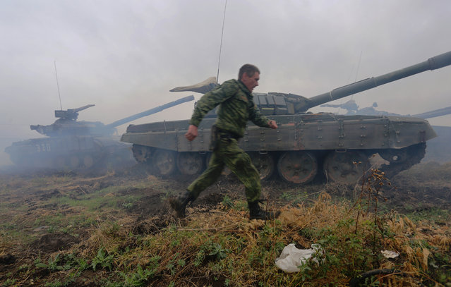 Pro-Russian separatists take part in a military competition between tank units near the town of Torez in the Donetsk region on September 14, 2015. EU member states formally approved on September 14 a six-month extension of sanctions against Ukrainian and Russian figures accused of backing pro-Moscow rebels fighting to break away from Kiev. (Photo by Aleksey Filippov/AFP Photo)