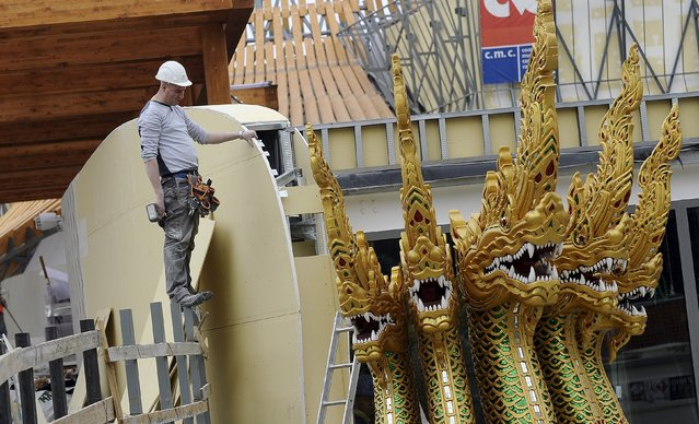 A worker is pictured at the Thailand pavilion at the Expo 2015 work site near Milan April 3, 2015. (Photo by Giorgio Perottino/Reuters)