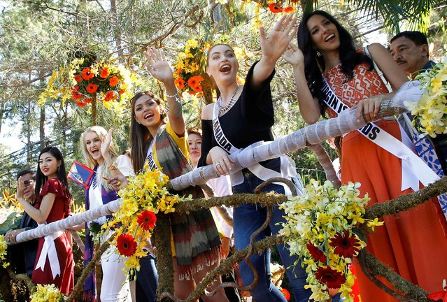 Miss Universe contestants wave to the crowd while onboard a float during their arrival and parade in Baguio city, north of Manila, Philippines January 18, 2017. Pictured are (from left): Sari Nakazawa, Miss Japan, Christina Waage, Miss Norway, Muneka Joy Cruz Taisipic, Miss Guam, Siera Bearchell, Miss Canada and Carolyn Carter, Miss U.S. Virgin Islands. (Photo by Harley Palanchao/Reuters)