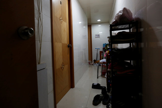 """A corridor shared by four sub-divided units is seen in Hong Kong, China January 6, 2017. For part-time furniture mover Kong Ngai-lam, 26, home is the bottom half of a bunk bed inside a tiny room that fits little else. Nearly 200,000 Hong Kong residents like him call a wire cage or bed in partitioned apartments their home. Making housing more affordable was among outgoing Hong Kong leader Leung Chun-ying's top priorities when he took office in 2012, but his administration has been unable to rein in skyrocketing prices that have added to discontent in the city. Property prices have surged nearly 50% to historic highs since he took office, according to government data, and tiny living spaces have become increasin gly common. About 100,000 people under the age of 35, including children, make up half of those occupying such partitioned units, a government report showed. Non-government organisations say the real numbers are higher. These units, measuring half the size of a standard car park space at an average of 62.4 square feet (5.8 square metres), are getting more expensive too. Median rents surged 10.5% to HK$4,200 (US$520) in 2015, official data showed. The figure is greater than the 8.4% rent increase in private homes over the same period. """"Mini flats"""" or """"mosquito flats"""" are a growing trend as developers target first-time buyers who have given up hope of ever owning a decent-sized home. (Photo by Bobby Yip/Reuters)"""