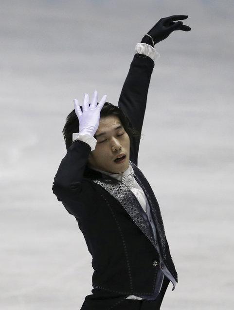 Takahito Mura of Japan performs during the men's free skating at the World Team Trophy Figure Skating Championships in Tokyo, Friday, April 17, 2015. (Photo by Koji Sasahara/AP Photo)