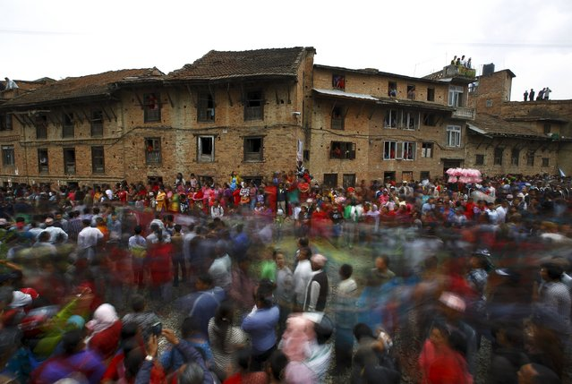 Devotees gather near the chariot of Rato Machhindranath during the chariot festival at Bungamati in Lalitpur April 22, 2015. (Photo by Navesh Chitrakar/Reuters)