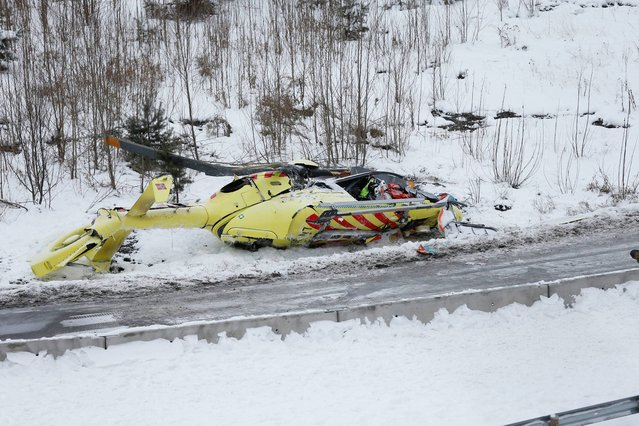 The wreckage of an ambulance helicopter in which two crew members were killed and one injured whilst attempting to attend at the site of a car accident in Sollihoegda, Norway, some 30 kilometers southwest of Oslo, Tuesday, January 14, 2014. (Photo by Cornelius Poppe/AP Photo/NTB Scanpix)