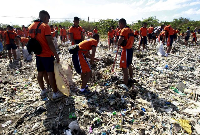 Members of Philippine Coastguard pick up trash at Freedom Island,  a marshland considered to be a sanctuary for birds, fishes and mangroves in a coastal area of Las Pinas city, south of Manila April 22, 2015, as part of their Earth Day campaign. Earth Day, which promotes awareness and protection of the environment, is celebrated annually on April 22. (Photo by Romeo Ranoco/Reuters)