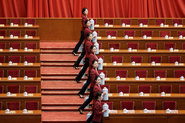 Attendants serve tea ahead of the opening session of the Chinese People's Political Consultative Conference (CPPCC) at the Great Hall of the People in Beijing, China March 3, 2019. (Photo by Jason Lee/Reuters)
