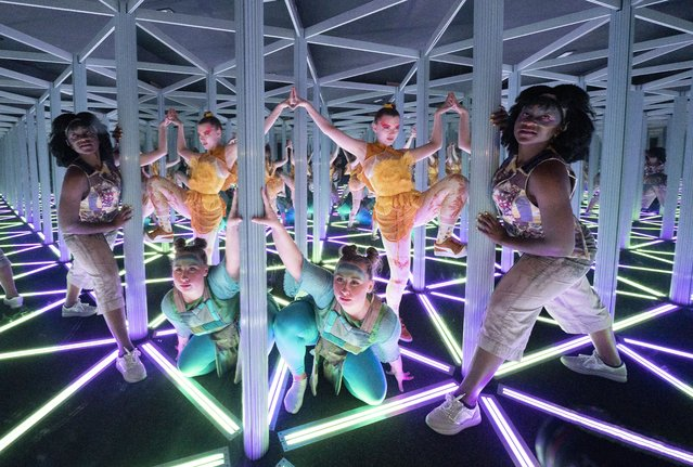 (L-R) Sophie Douglas, Caitlin Anderson and Emmanuella Damptey, who play aliens from the planet Hanyana in the Edinburgh Fringe show WeCameToDance, explore the giant kaleidoscope at Camera Obscura & World of Illusions, Edinburgh, Scotland on Thursday, August 26, 2021. (Photo by Jane Barlow/PA Images via Getty Images)