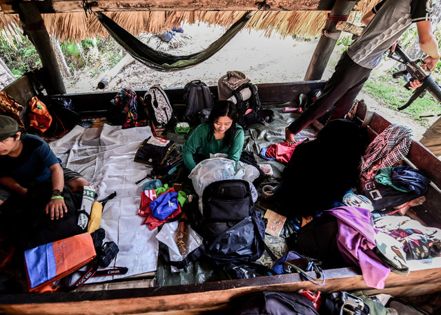 Ka Kathryn (Comrade Kathryn) (C), one of the fighters of the New People's Army-Melito Glor Command (NPA-MGC), sits with her personal belongings inside a makshift hut at an undisclosed location in the mountains of Sierra Madre, Philippines, 31 March 2019. (Photo by Alecs Ongcal/EPA/EFE)