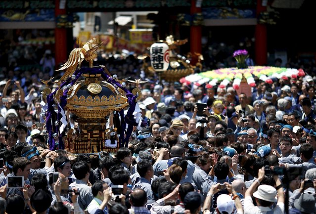 Local residents carry portable shrines into the Kanda-Myojin shrine during the Kanda festival in Tokyo, Japan, May 10, 2015. (Photo by Yuya Shino/Reuters)