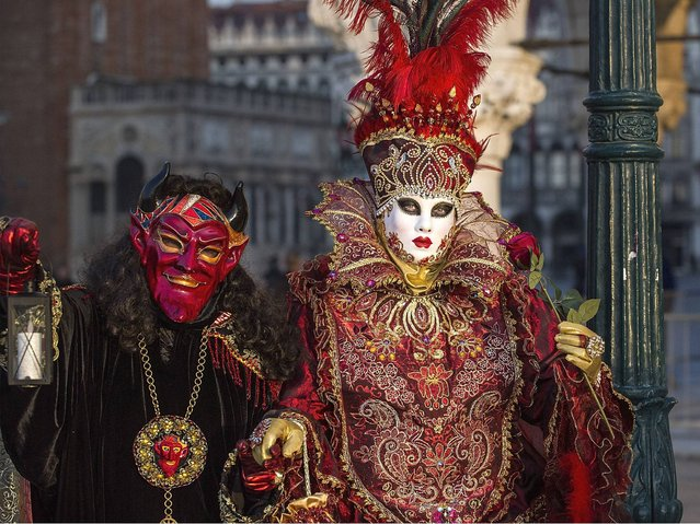 St Mark's Square is the centre of Carnival activities, and that's where the most extraordinary costumes can be spotted. (Photo by Marco Secchi/Getty Images)