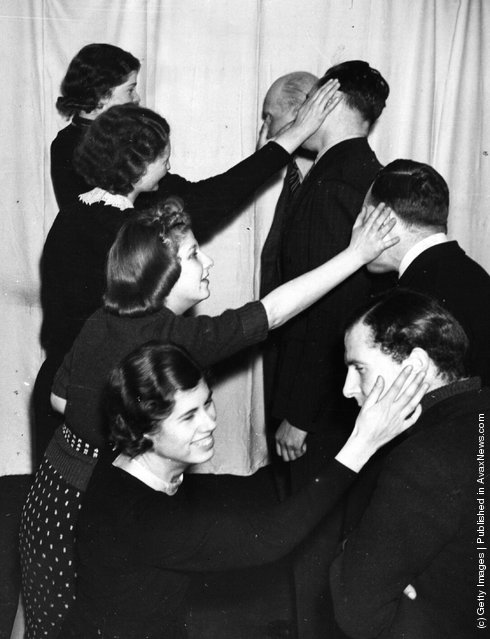 1939: Four students at a Liverpool drama school enjoy a lesson in face-slapping