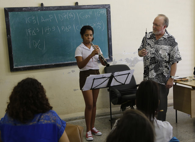 Cuban National Art School student Betsy Brizuela plays the oboe as Minnesota Orchestra oboe player John Snow conducts a master class in Havana, Cuba, Thursday, May 14, 2015. The Minnesota Orchestra will offer two concerts in Havana and is the first major U.S. orchestra to play in Cuba since 1999. The trip cost nearly $1 million. (Photo by Desmond Boylan/AP Photo)