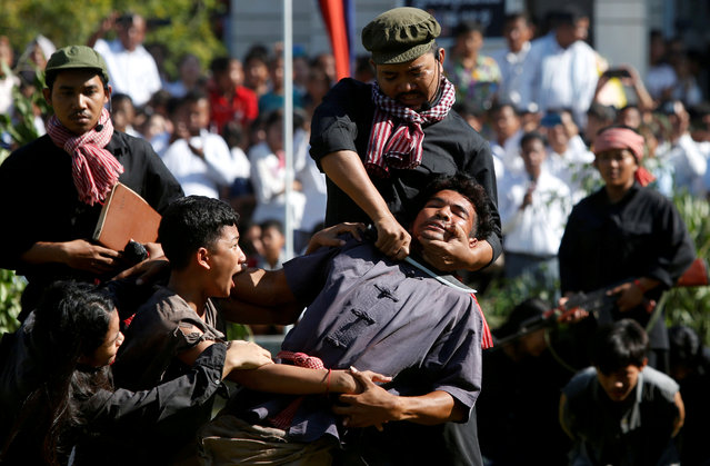 """Actors reenact a scene based on the Khmer Rouge regime tactics during the annual """"Day of Anger"""" where people gather to remember those who perished during the Communist regime's rule, on the outskirts of Phnom Penh, Cambodia, May 20, 2019. (Photo by Samrang Pring/Reuters)"""