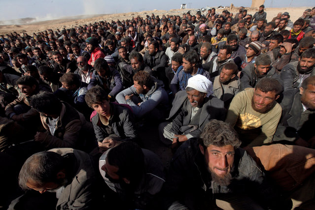 Displaced Iraqis wait for a security check at an Iraqi security forces base in western Mosul, Iraq February 26, 2017. (Photo by Alaa Al-Marjani/Reuters)
