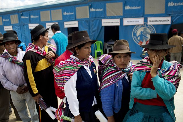 Villagers wait in a line to be attended by doctors in Surcubamba, Peru, Thursday, May 21, 2015. (Photo by Rodrigo Abd/AP Photo)