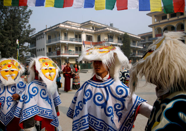 """Tibetans in traditional attire wait to perform traditional mask dance during a function organised to mark """"Losar"""", or the Tibetan New Year, in Kathmandu, Nepal March 1, 2017. (Photo by Navesh Chitrakar/Reuters)"""