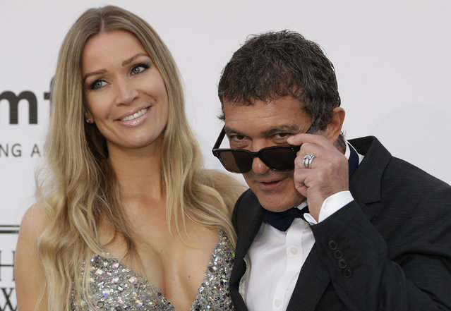Actor Antonio Banderas, right, and Nicole Kimpel pose for photographers upon arrival for the amfAR Cinema Against AIDS benefit at the Hotel du Cap-Eden-Roc, during the 68th Cannes international film festival, Cap d'Antibes, southern France, Thursday, May 21, 2015. (Photo by Thibault Camus/AP Photo)