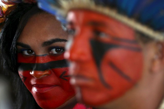 Indigenous people are pictured in a tent at the camp, ahead of the impeachment process vote of Brazil's President Dilma Rousseff in the lower house in Brasilia, Brazil, April 15, 2016. (Photo by Adriano Machado/Reuters)