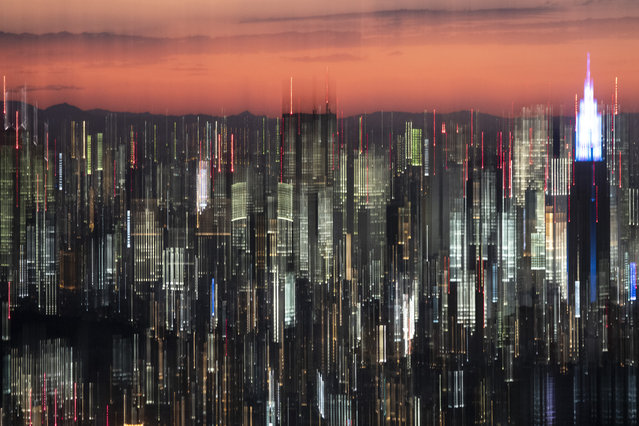 In this panned photo, Tokyo's skyline is seen at dusk from the Roppongi Hills Mori Tower Monday, June 17, 2019, in Tokyo. (Photo by Jae C. Hong/AP Photo)