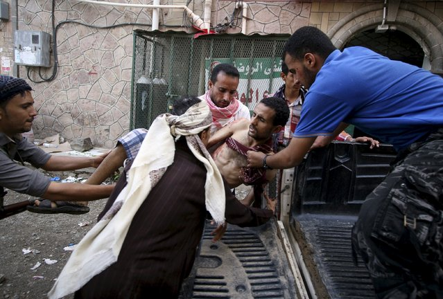 A fighter of the Popular Resistance Committee is being rushed to a hospital after he was injured during clashes with Houthi fighters in Yemen's southwestern city of Taiz May 11, 2015. (Photo by Reuters/Stringer)