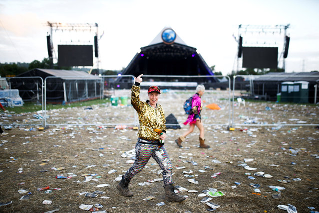 Festival goers are seen in the early hours of the morning following the end of Glastonbury Festival in Somerset, Britain on July 1, 2019. (Photo by Henry Nicholls/Reuters)