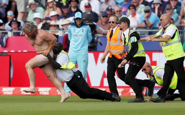 A pitch invader attempts to evade a security official during the 2019 Cricket World Cup group stage match between England and New Zealand at the Riverside Ground, in Chester-le-Street, northeast England, on July 3, 2019. (Photo by Lee Smith/Action Images via Reuters)
