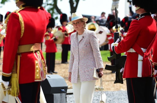 Belgium's Princess Astrid, center, arrives for the ceremonial opening of Hougoumont Farm in Braine-l'Alleud, near Waterloo, Belgium on Wednesday, June 17, 2015. Hougoumont Farm played a critical role in the outcome of the Battle of Waterloo, and the newly restored farm will open to the general public on June 18, 2015. (AP Photo/Emmanuel Dunand/Pool Photo via AP)
