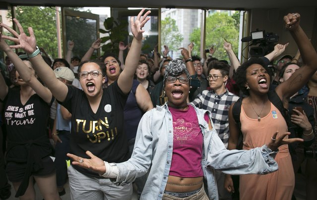 Krys Didtrey, left, and Gloria Merriweather, center, of Charlotte, N.C. lead the chants in opposition to House Bill 2 during a protest in the lobby of the State Legislative Building in Raleigh, N.C. on Monday April 25, 2016. A large group of people starting chanting in the lobby moment after the House adjourned for the evening.  (Photo by Robert Willett/The News & Observer via AP Photo)