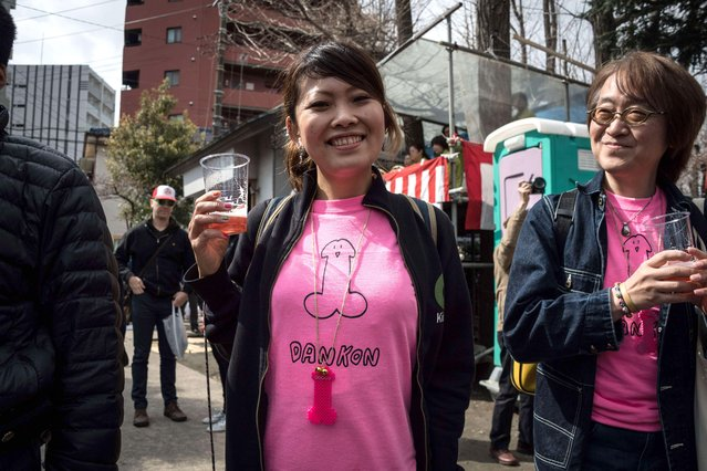 Festival goer with phallus logo t-shirt during the Kanamara Matsuri Steel Phallus Festival at Kawasaki, Japan on April 2, 2017. The Kanamara Matsuri or Festival of the Steel Phallus is held on the first Sunday of April at the Kanayama shrine. The shrine celebrates a legend of a steel pen*s and was frequented by prostitutes who wished to pray for protection from sexually transmitted diseases. Visitors now wish for easy delivery, marriage and matrimonial harmony. Because of the large steel phallus the unusual festival has become a tourist attraction attracting many overseas visitors and is used to raise money for HIV charities. Phallus shaped candy, carved vegetables, decorations, and a big parade are all part of the festival. (Photo by DELETREE/SIPA Press/Rex Features/Shutterstock)