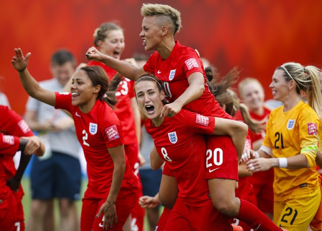 From left to right, England's Alex Scott, Jill Scott, Lianne Sanderson and goalkeeper Carly Telford celebrate after defeating Germany in FIFA Women's World Cup soccer third-place match in Edmonton, Alberta, Canada on Saturday, July 4, 2015. (Photo by Jeff McIntosh/The Canadian Press via AP Photo)