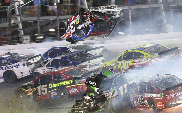 Austin Dillon (3) goes airborne as he was involved in a multi-car crash on the final lap of the NASCAR Sprint Cup series auto race at Daytona International Speedway, Monday, July 6, 2015, in Daytona Beach, Fla. (Photo by Stephen M. DoweLl/The Orlando Sentinel via AP Photo)