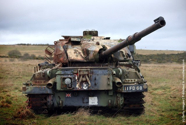 Wrecked tanks are seen close to the road that leads to the village of Imber on Salisbury Plain, England