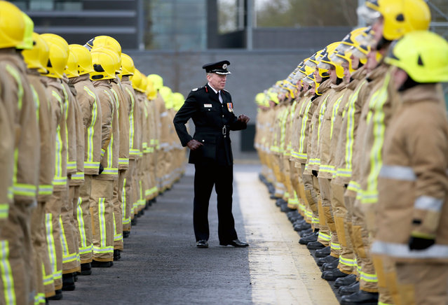 Assistant Chief Officer Lewis Ramsay inspects some of the 101 new full-time firefighters during their graduation ceremony at the Scottish Fire and Rescue Service National Training Centre in Cambuslang, Glasgow, UK on April 21, 2017. (Photo by Jane Barlow/PA Wire)