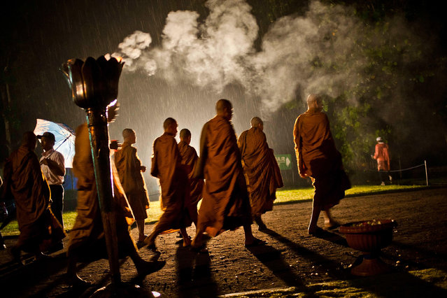 "Buddhists monks walk around the Borobudur temple during Vesak Day, commonly known as ""Buddha's birthday"", at the Borobudur Mahayana Buddhist monument on May 6, 2012 in Magelang, Indonesia. (Photo by Ulet Ifansasti/Getty Images)"