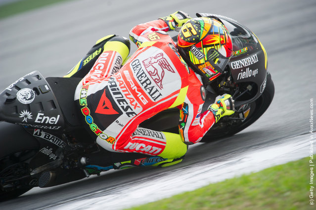 Valentino Rossi of Italy and  and Ducati Marlboro Team rounds the bend during the third day of MotoGP testing at Sepang Circuit