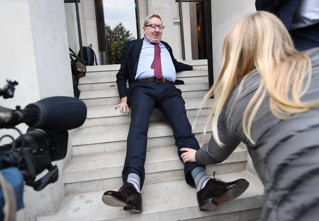 British Trade Union leader Len McCluskey falls on the steps outside the Clause 5 Labour meeting to finalise the Labour manifesto in London, Britain, 11 May 2017. The party's draft manifesto was reportedly leaked overnight in the run up to the feneral election on 08 June 2017. (Photo by Andy Rain/EPA)