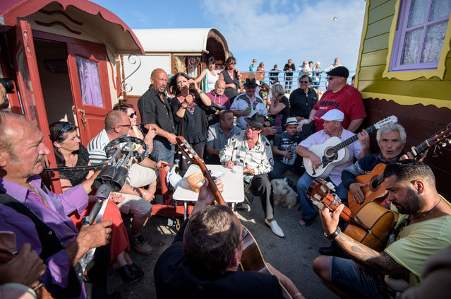 Gypsies sing and play guitar between their folklore wagons on May 24, 2016 in Staintes Maries de la Mere near Arles, France. (Photo by Thomas Lohnes/Getty Images)