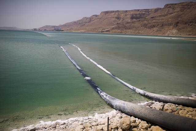 Pipes that pump water cross through evaporation pools, which today make up the southern part of the Dead Sea, Israel July 27, 2015. (Photo by Amir Cohen/Reuters)