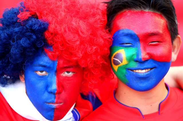 South Korea fans with painted faces enjoy the atmosphere prior to the 2014 FIFA World Cup Brazil Group H match between South Korea and Algeria at Estadio Beira-Rio on June 22, 2014 in Porto Alegre, Brazil. (Photo by Jeff Gross/Getty Images)