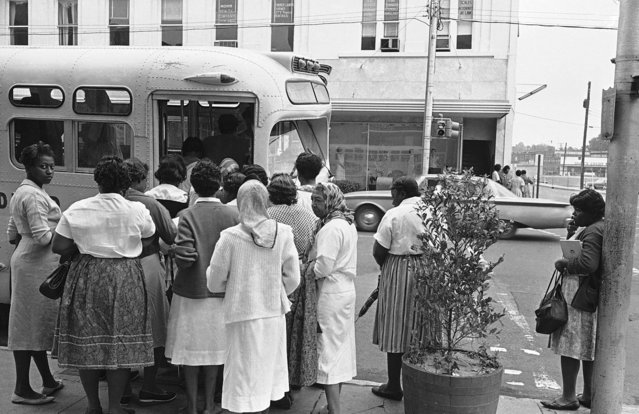 Blacks  board buses at the corner of Capitol St. and Roach St., April 23, 1962 in Jackson, Miss. Despite boycott scheduled to begin by the Jackson Non-Violent Committee, there was no appreciable loss of traffic due to the boycott and there were no incidents. (Photo by Charles Kelly/AP Photo)